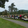 golfers in carts lined up and ready